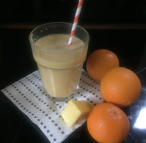 Orange and Mango smoothie with a straw